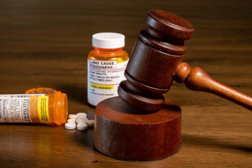 Pharmaceutical Liability pill bottles and judge's gavel