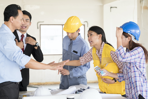 group of people arguing in a construction setting